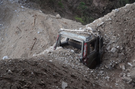 Vehicles were dumped by Rocks and mud. Here many people died.